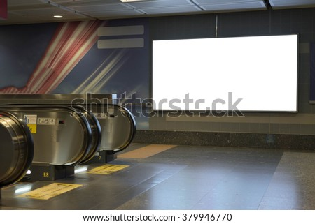 Blank bill board for advertising in front of escalator - stock photo