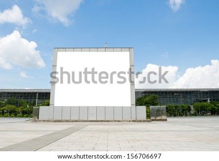 Blank billboard against blue sky.