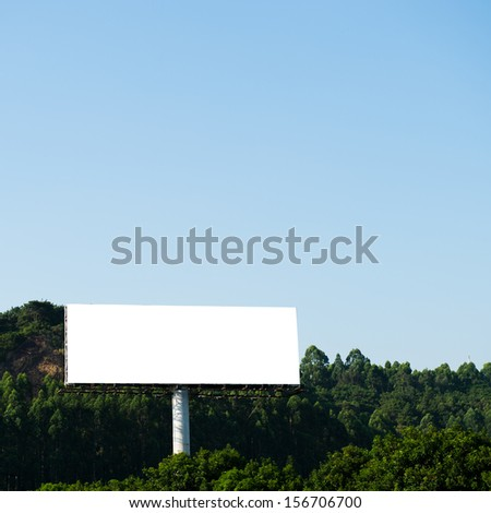 Blank billboard against blue sky. - stock photo