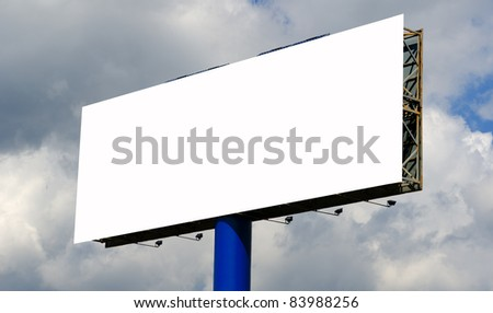 Blank billboard against the cloudy sky