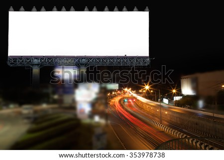 blank billboard and light on highway road in night time - stock photo