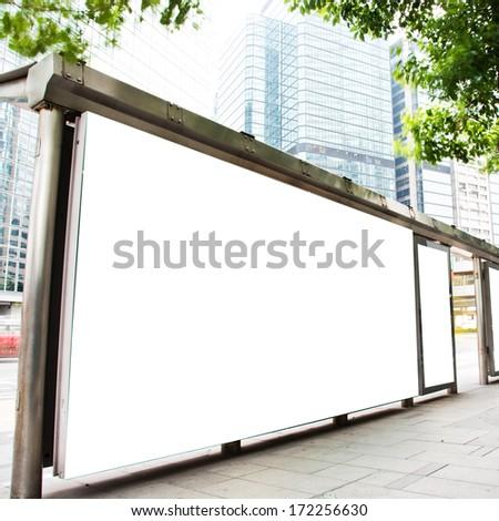 Blank billboard at a bus stop. - stock photo