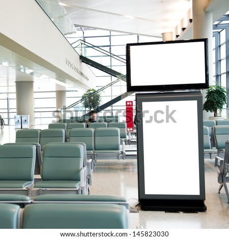 Blank billboard at a international airport. - stock photo