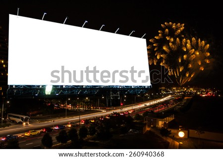 blank billboard at city street on night with fireworks. - stock photo