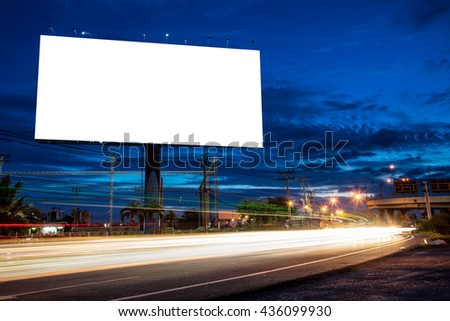 Blank billboard for advertisement at twilight time with light trails on the road at dusk, business advertising concept.