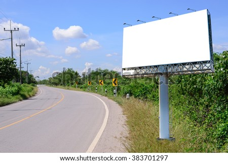 Blank billboard for advertising near windig road with blue sky.
