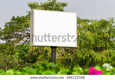 Blank billboard for new advertisement, with green flowers trees and blue sky white cloud