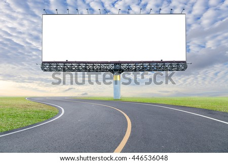 Blank billboard for your advertisement with space for text on road curve,with green grass and blue sky white cloud