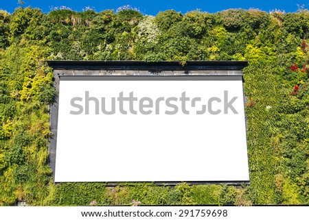 Blank billboard in a green building, for advertisement