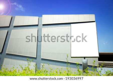 Blank billboard in front of modern building in a city. Put your advertising here