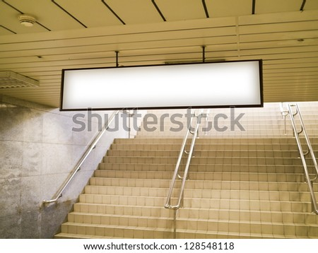 blank billboard in metro station - stock photo