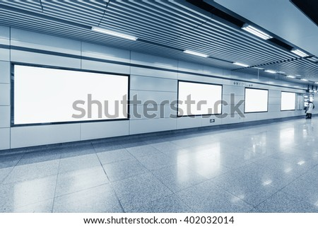 blank billboard in metro station with bright corridor