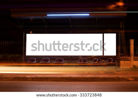 Blank billboard in night with long exposure light at bus stop - stock photo