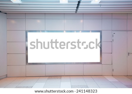 Blank billboard in subway station.Useful for your advertising.