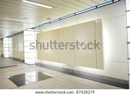 Blank billboard in underground passage. - stock photo