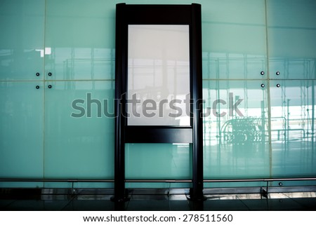 Blank billboard indoors of metro or airport hall, advertising mock up, public information board - stock photo