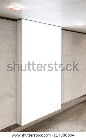 Blank billboard located in underground hall useful for your advertising - stock photo