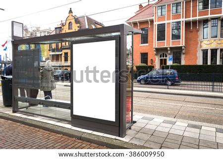 Blank billboard on a roadside in european city - stock photo