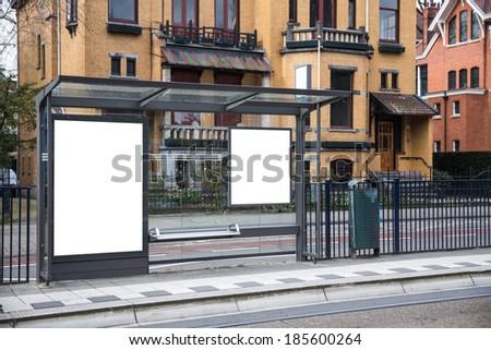 Blank billboard on a roadside in european town - stock photo