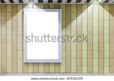Blank billboard on a wall in subway underground with copy space - stock photo