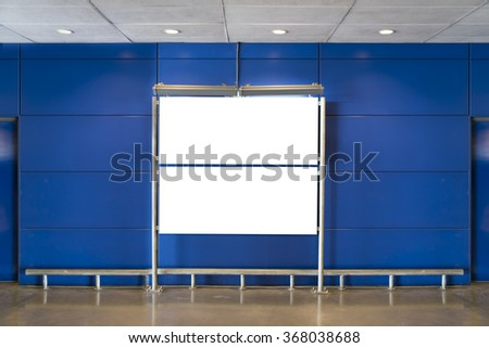 Blank billboard on blue wall background. - stock photo