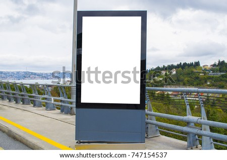blank billboard on city street at outdoor advertising