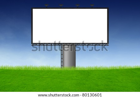 Blank billboard on green field and the blue sky in background