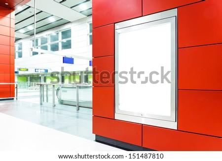 Blank billboard on modern subway background - stock photo