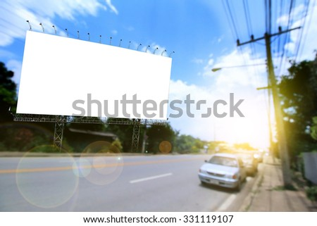 blank billboard on road and blue sky with soft and flare light
