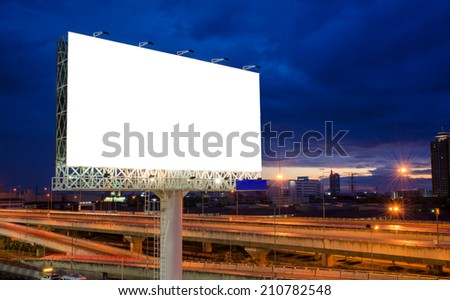 Blank billboard on road at twilight time for advertisement. - stock photo