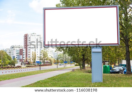 Blank billboard on road in city useful for advertising - stock photo