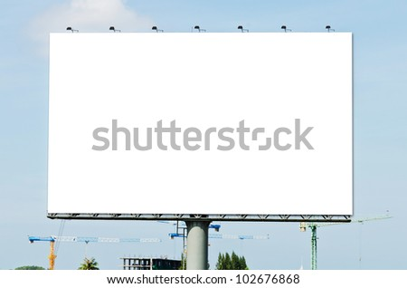 Blank Billboard on the blue sky in the City. - stock photo