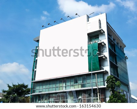 Blank billboard on the building. Useful for your advertisement.  - stock photo
