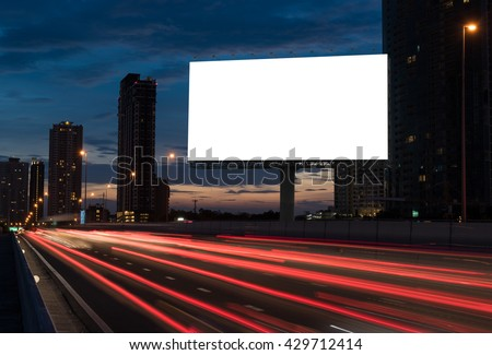 blank billboard on the highway, blank billboard during the twilight light, blank billboard in city background. With clipping path on screen.- can be used for display your products or promotional - stock photo