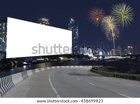 Blank billboard on the highway with a background blur of city. With clipping path on screen - can be used for trade shows, and advertising or promotional poster for you.