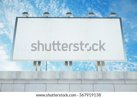 Blank billboard on the roof of building at blue sky background, mock up - stock photo