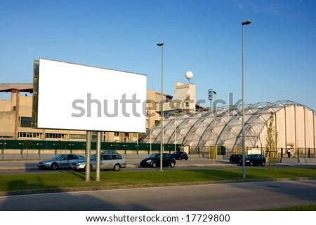Blank billboard on the street outside a stadium - stock photo