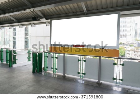 Blank billboard or poster located in sky train station - stock photo