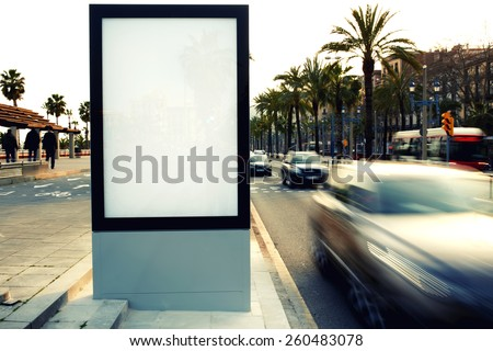 Blank billboard outdoors, outdoor advertising, public information board on city road, filtered image, cross process - stock photo
