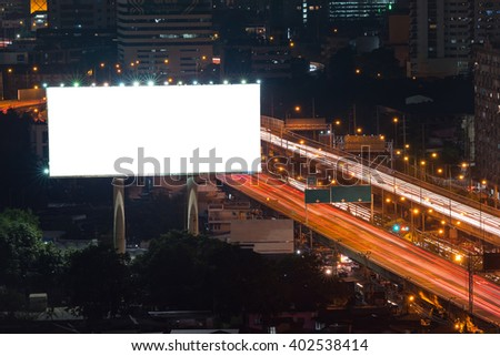 Blank billboard ready for new advertisement at expressway at night in downtown city - stock photo