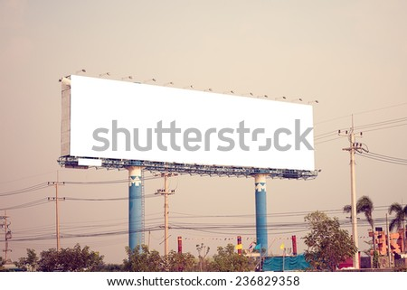 Blank billboard ready for new advertisement. Vintage filter. - stock photo