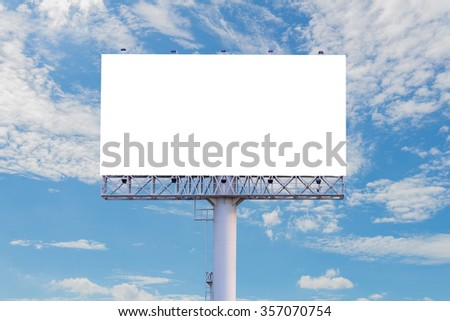 Blank billboard ready for new advertisement with blue sky background.