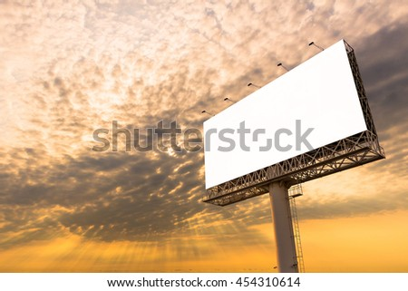 Blank billboard ready for new advertisement with sunset background.