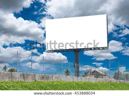 Blank billboard with a background of sky. With clipping path on screen - can be used for trade shows, and advertising or promotional poster for you.