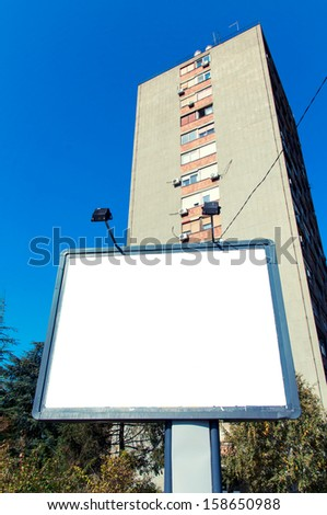 Blank billboard with big building in the background - stock photo