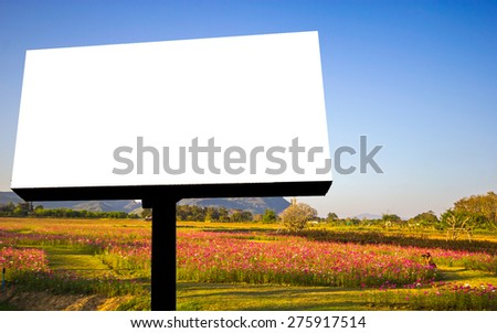 blank billboard with cloudy and blue sky background.