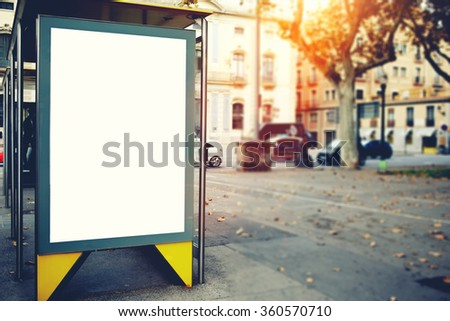Blank billboard with copy space area for your text message or promotional content, public information board on the street, advertising mock up empty banner in metropolitan city at beautiful evening  - stock photo
