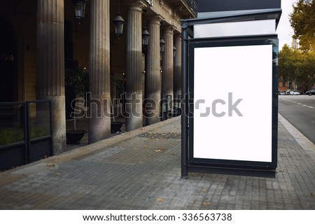 Blank billboard with copy space screen for your text message or promotional content, public information board on the street, advertising mock up outdoors, empty poster in urban setting  - stock photo