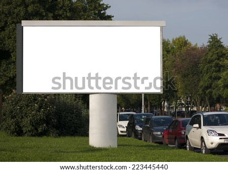 Blank Billboard with parked cars - stock photo