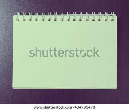 Blank binder note book paper page. Vintage tone on space for text on page. - stock photo